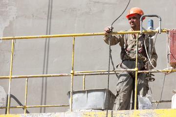 Plasterer lifting in Building hoist Construction Elevator Cradle