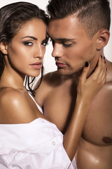 sexy impassioned couple posing in studio