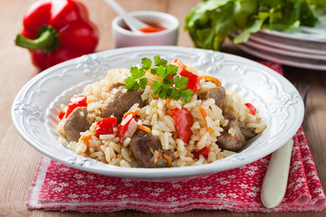 stewed rice with meat and red peppers