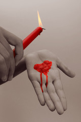 Special toned photo of female hands holding red wax candle