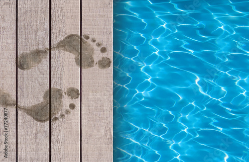 Swimming pool and wooden deck ideal for backgrounds - 77240877
