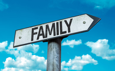 Family sign with sky background