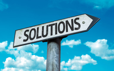 Solutions sign with sky background