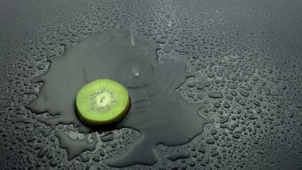 slice kiwi fruit rinse on wet slow motion