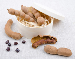Dried Tamarind Fruits With Seeds In A Box On Linen