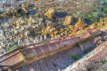 stairs to the rocky shore