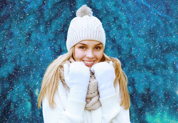 Christmas, winter and people concept - pretty woman outdoors