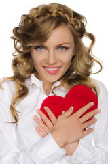 smiling woman pushes heart to himself