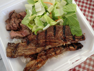 Steak, Kalbi, Side salad and white rice in a styrofoam plate