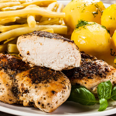 Fried chicken fillets, boiled potatoes and vegetable salad
