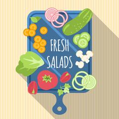 Verduras sobre una tabla cortadas para la ensalada