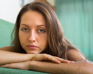 Depressed woman on sofa