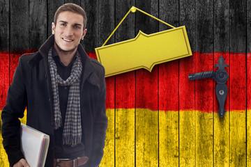 Student vor Deutschlandholztüre