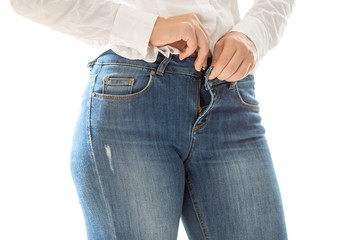 sexy woman putting on blue jeans