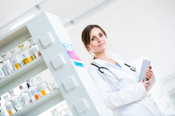 Pretty, female doctor in a hospital lab