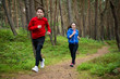 Healthy lifestyle - girl and boy running, jumping outdoor