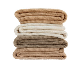 Four colored bath towels in stack isolated over white