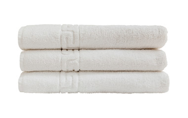 White bath towels in stack. Isolated