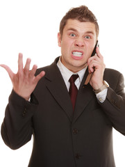 angry business man talking on phone.