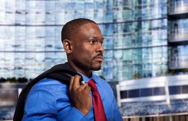 Businessman holding his jacket on the shoulder