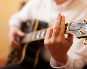 Guitarist playing an archtop guitar
