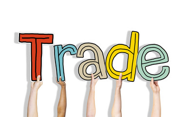 Diverse Hands Holding Word Trade Concept