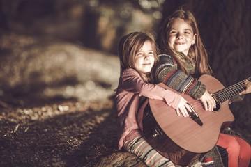 Young Girls Playing Guitar