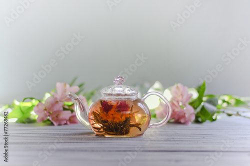Fotobehang Thee Flower green tea in a glass pot on a table