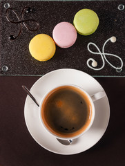 French macaroon dessert with a cup of coffee