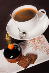 Beautifully decorated dessert with a cup of coffee
