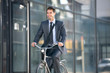active young businessman on bike