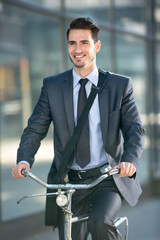 businessman riding a bicycle to work