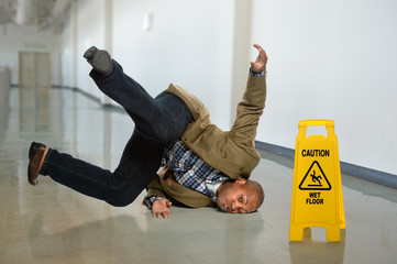 Businessman Falling on Wet Floor