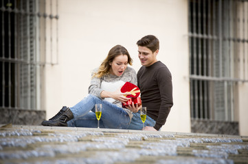 young couple in love for Valentines day presents and toast