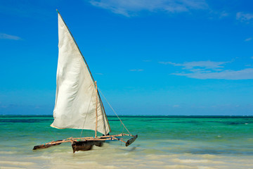 Wooden sailboat (dow) on water, Zanzibar island