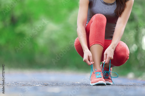 Fotobehang Persoonlijk Running shoes - closeup of woman tying shoe laces