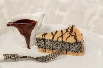 German poppy seed cake on white plate
