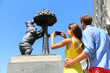 Tourists taking pictures of bear statue in Madrid