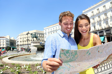 Tourists couple with map in Madrid, Spain