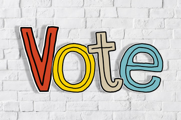 The Word Vote on a Brick Wall