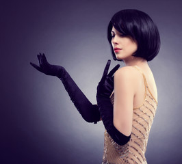 beautiful young woman with stylish hairstyle and black gloves.
