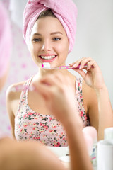Cute girl brushing teeth