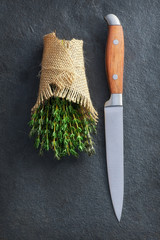 Bunch of fresh thyme with knife