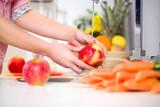 Woman hands washing tasty apple
