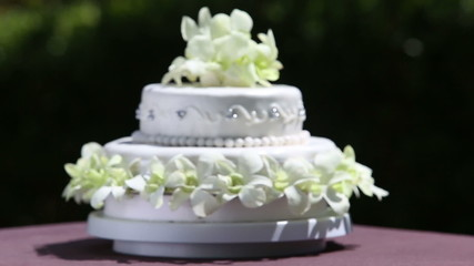 focusing on fresh white orchid and beads decorated wedding cake