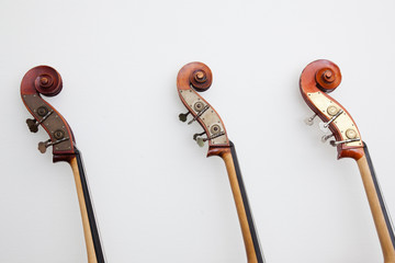 heads of three double basses in a row