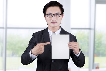 Businessman showing empty placard 1