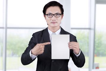 Businessman showing empty placard 1