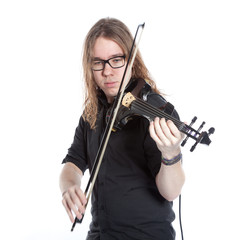 young man with glasses plays electric violin in studio