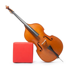 double bass leans against red box